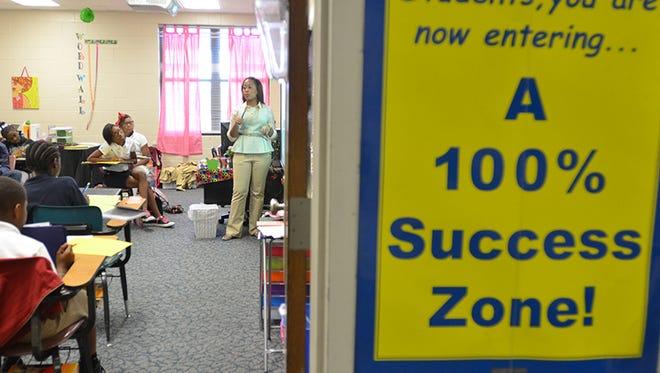 Northwest Jackson Middle School sixth grade teacher Ashley Carpenter works with her students.