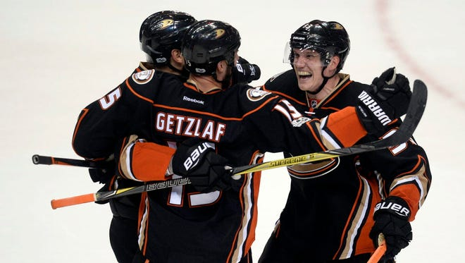 Anaheim Ducks center Ryan Getzlaf (15) is congratulated by left wing Jakob Silfverberg (33) after scoring a goal against the Calgary Flames during the third period of Game 2.