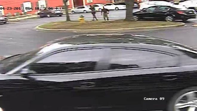 Tallahassee Police say the vehicle and the men in this photo may have been involved in a shooting at a large party at The Commons Sunday.