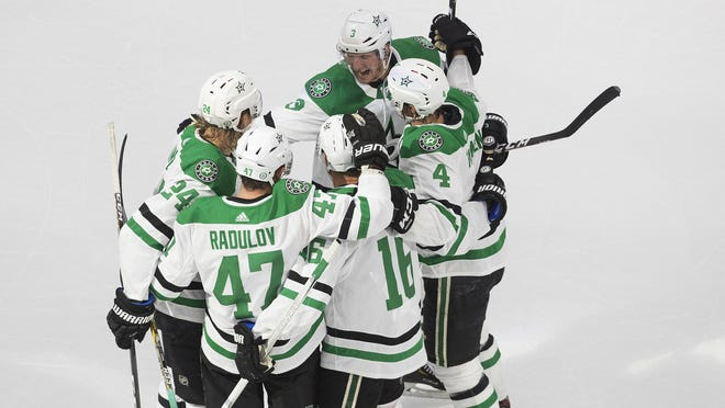 The Dallas Stars celebrate a goal against the St. Louis Blues during third period on Sunday.