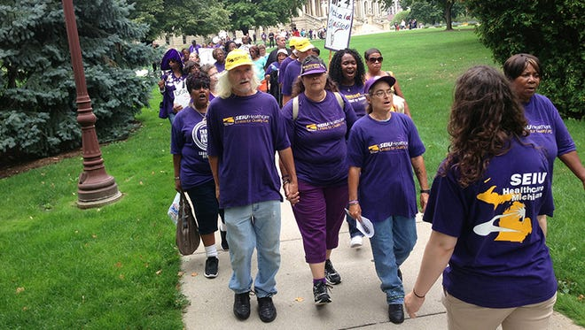A group of nearly 100 protesters, many affiliated with the AFL-CIO, came to the Michigan state Capitol in Lansing on Aug. 27, to urge the Senate to take a vote to support Medicaid expansion.