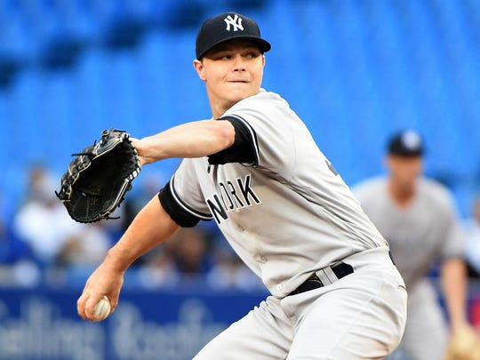 New York Yankees starting pitcher Sonny Gray (55) delivers a pitch against Toronto Blue Jays in the first inning at Rogers Centre.