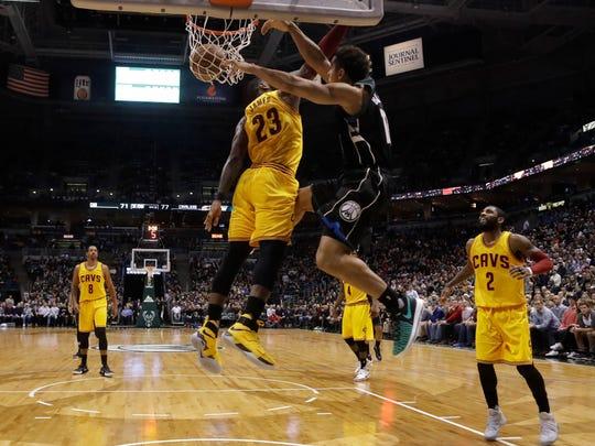 Malcolm Brogdon dunks over LeBron James in December.