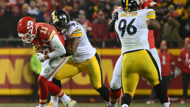 Jan 15, 2017: Kansas City Chiefs quarterback Alex Smith (11) is tackled by Pittsburgh Steelers outside linebacker James Harrison (92) during the third quarter in the AFC Divisional playoff game at Arrowhead Stadium.