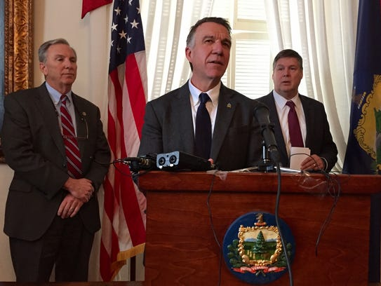 Gov. Phil Scott speaks at a news conference in Montpelier on Feb. 22, 2018, flanked by Department of Public Safety Commissioner Tom Anderson, left, and Agency of Human Services Secretary Al Gobeille.