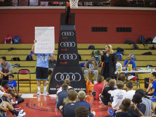 Nutritionist Jen Stein talks to kids at a Rutgers youth