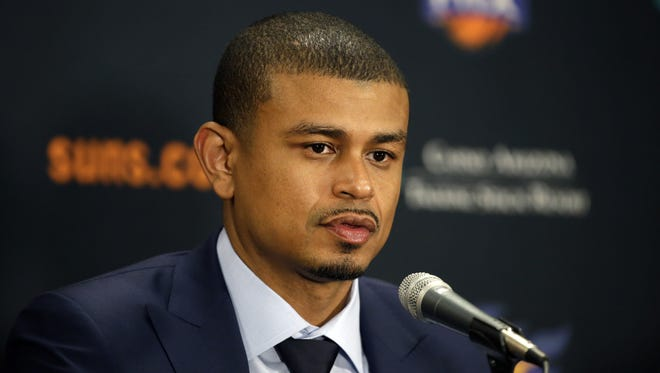 Earl Watson is introduced as the Phoenix Suns new head coach by Suns General Manager Ryan McDonough during a press conference at Talking Stick Resort Arena in Phoenix, Ariz., on Tuesday, April 19, 2016.