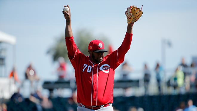 Cincinnati Reds relief pitcher Jumbo Diaz (70) stretches before delivering a pitch in the bottom of the third inning.