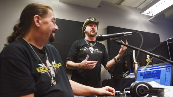 "Crash, left, and ""Metal Cowboy"" Ron Keel, right, host KBACK radio live Monday, Jan. 29, at their new studio in downtown Sioux Falls."