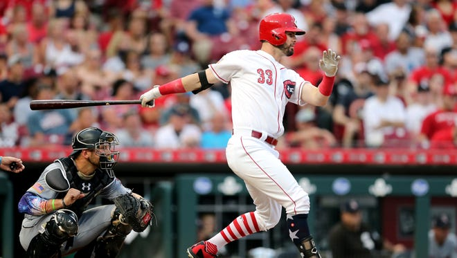 Cincinnati Reds right fielder Jesse Winker (33) hits a two-run single in the fourth inning during an interleague baseball game between the Chicago White Sox and the Cincinnati Reds, Wednesday, July 4, 2018, at Great American Ball Park in Cincinnati.