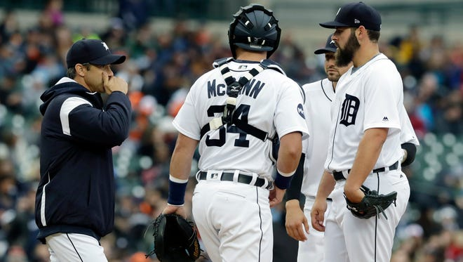 Tigers manager Brad Ausmus, left, visits the mound to talk with pitcher Michael Fulmer, right, during the third inning Saturday at Comerica Park.