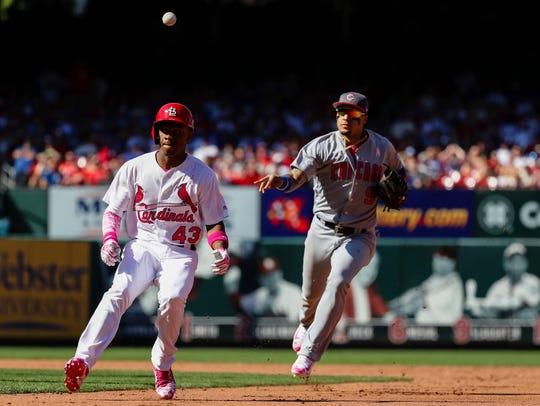 St. Louis Cardinals' Magneuris Sierra, left, is caught