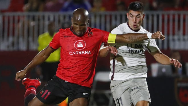 Phoenix Rising's Didier Drogba (11) takes a shot against Sacramento Republic's Cameron Iwasa (31) at the Phoenix Rising Soccer Complex in Tempe, Ariz. on May 19, 2018.