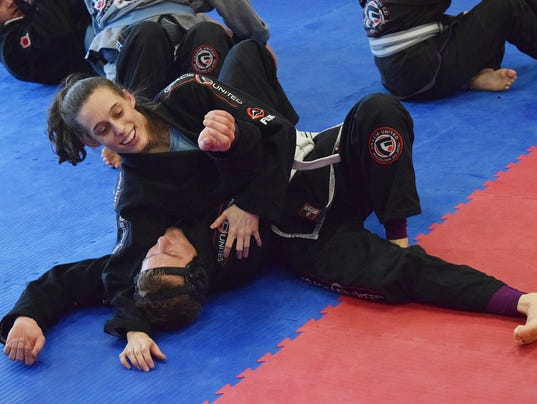 """Casey Killingsworth is a former ballerina who said Brazilian jiu jitsu reminded her of ballet because both have sequential body movements that can be memorized. """"I really wanted to do something that was active,"""" she said. And by doing Brazilian jiu jitsu,"""