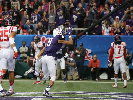 TCU wide receiver Josh Doctson celebrates after scoring a touchdown last season in the Peach Bowl against Ole Miss. The Rebels want to perform better in their second consecutive New Year's Six Bowl on Friday against Oklahoma State.