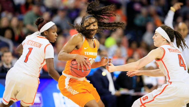 Tennessee guard Te'a Cooper, center, drives upcourt between Syracuse defenders Alexis Peterson, left, and Maggie Morrison, right, during the second half of a regional final women's college basketball game in the NCAA Tournament, Sunday, March 27, 2016, in Sioux Falls, S.D.