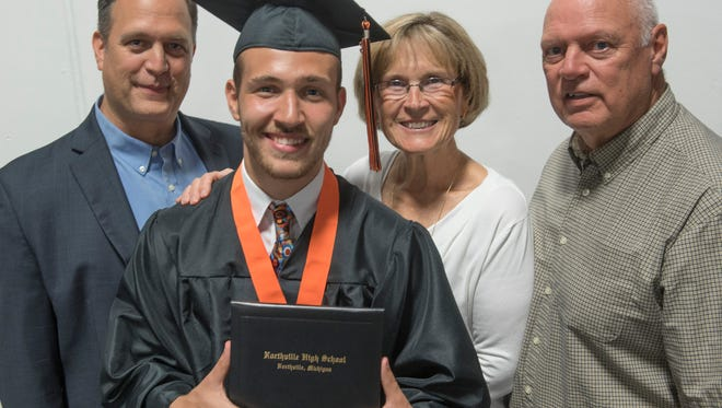 Dean Hubbert graduates from Northville High School, the fourth generation of the family to do so. With Dean is his father, Tim Hubbert, and grandparents Dianne and Bob Hubbert.