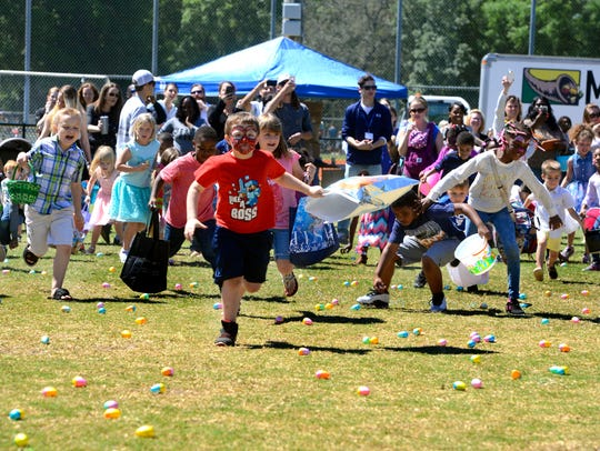 Kids dash around the field gathering up Easter Eggs during last year's Easter Egg Hunt at the Roger Scott Athletic Complex. This year's event is set for Saturday.