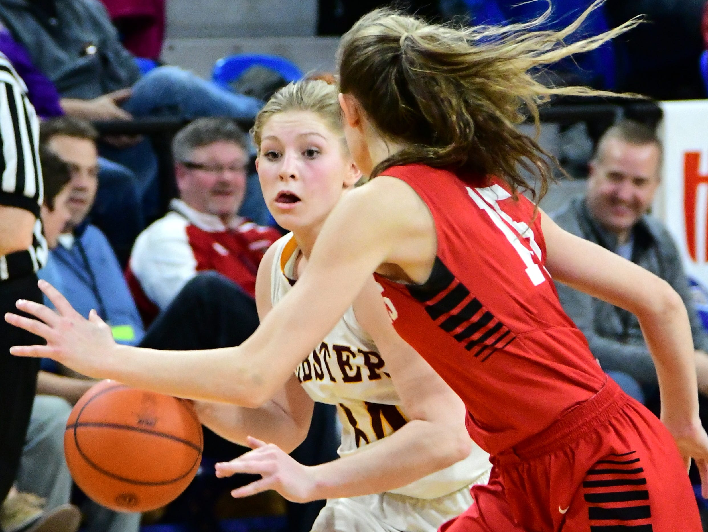 Webster's Haley Rithmiller tries to get past Vermillion's Kasey Herbster during the Class A girls 3rd place game Saturday at Frost Arena.