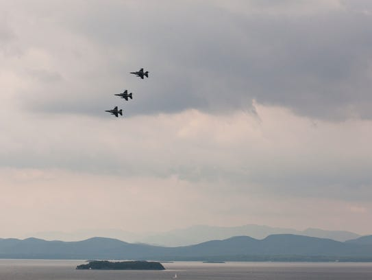 Jet fighters fly in formation over Lake Champlain in