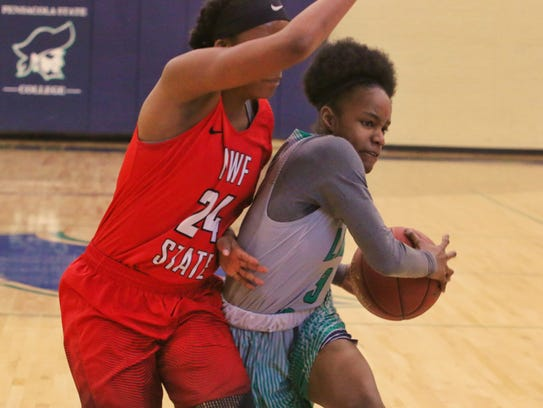 Pensacola State's Nia Johnson tries to drive around