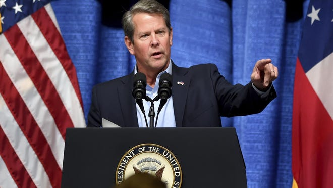 In this Thursday, Nov. 1, 2018, file photo, Georgia Gov. Brian Kemp speaks during a rally at the Columbia County Exhibition Center in Grovetown, Ga.