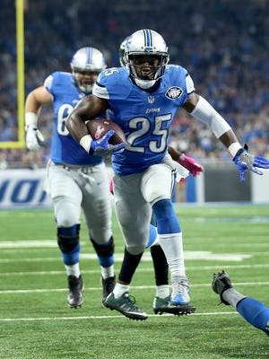 Theo Riddick of the Detroit Lions runs for his second touchdown against the Philadelphia Eagles on Oct. 9, 2016, in Detroit.