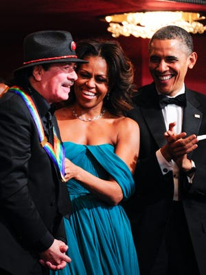 President Obama and first lady Michelle Obama join musician and songwriter Carlos Santana, who is among the artists recognized at the 36th annual Kennedy Center Honors, to be broadcast Sunday on CBS.