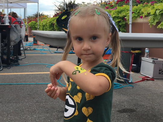 Kaydence Reseberg, 3, of Campbellsport, shows off her