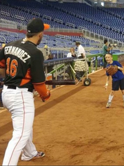 Jose Fernandez plays catch with Casey McGehee's son,