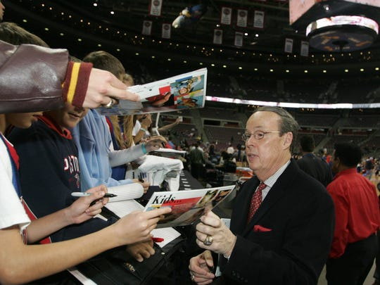 Veteran announcer George Blaha has been the voice at the Pistons since the 1976-77 season. He signs autographs for fans in 2005.