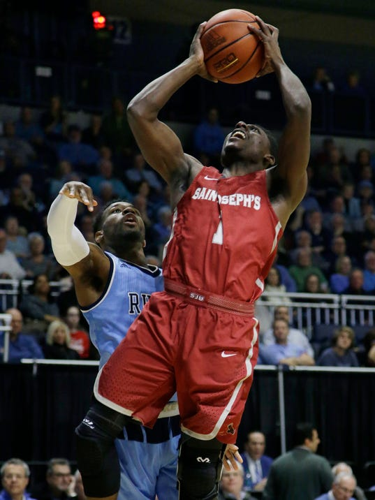 Saint Joseph's guard Shavar Newkirk (1) takes the ball to the hoop after getting by Rhode Island guard Jarvis Garrett (1) during the first half of their NCAA college basketball game at the Ryan Center Tuesday, Feb. 27, 2018, in South Kingstown, R.I. (AP Photo/Stephan Savoia)