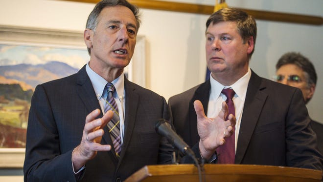 Gov. Peter Shumlin, left, and Al Gobeille, chairman of the Green Mountain Care Board, right, outline details of an All Payer Model for health care services at a news conference in Montpelier on Monday, January 25, 2016.