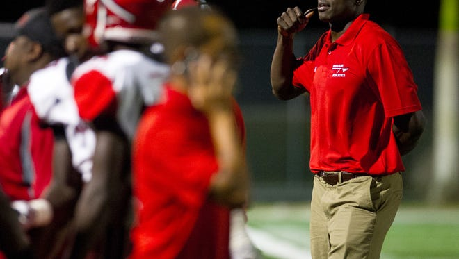 Immokalee High Schools head coach Rodelin Anthony talks to his team before the start of a game against Gulf Coast High School on Friday, Aug. 19, 2016 in Naples, Florida.