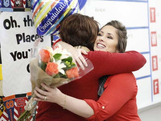 Deerlake Middle School teacher Jessica Smithson hugs her sister Jennifer Powell after she was surprised with the LCS Teacher of the Year award in her classroom at Chiles High School Wednesday.