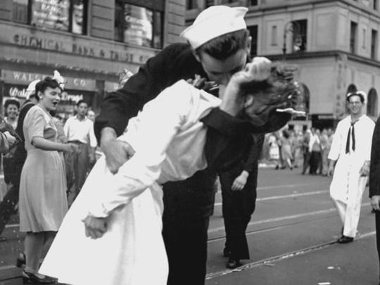 A slightly different angle of the couple kissing that was memorialized by photojournalist Alfred Eisenstaedt on Aug. 14, 1945.