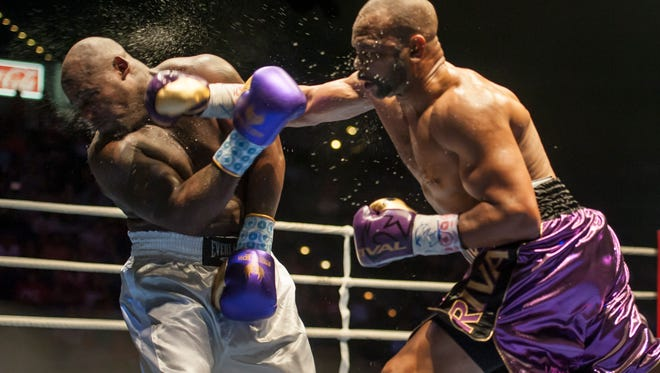 Former world champion and Pensacola native Roy Jones Jr. lands a punch during Island Fights 38. Jones announced Thursday he'll fight in Island Fights 46 at the Pensacola Bay Center on Feb.8.