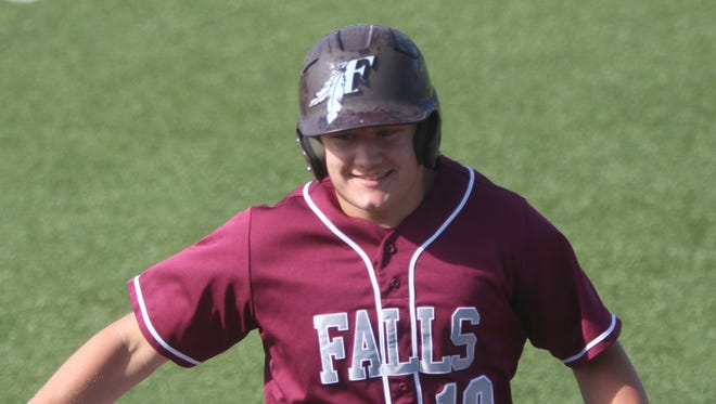 Menomonee Falls senior Ryan Spalding reacts after hitting a sacrifice fly in a game against Oak Creek June 20. The win was part of a big week for Falls.