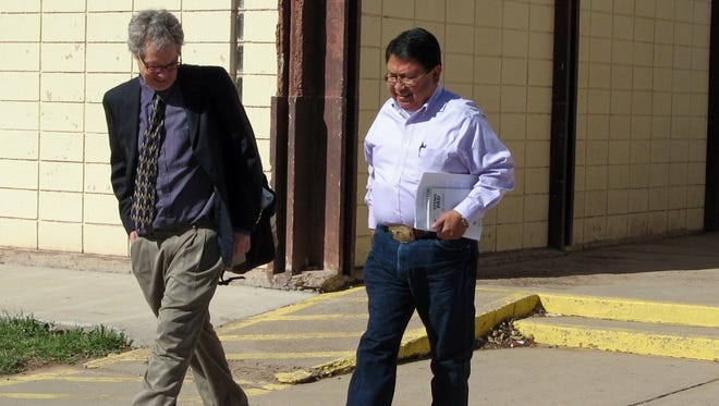 Navajo Nation Council Delegate Mel R. Begay, right, walks with his attorney, Jeffery Rasmussen, after Begay's pre-trial hearing in Window Rock District Court in Window Rock, Ariz.