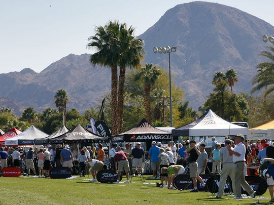 Golfers try out a variety of clubs at the manufacturers tents at the Pete Carlson's Golf Expo at the College Golf Center in Palm Desert.