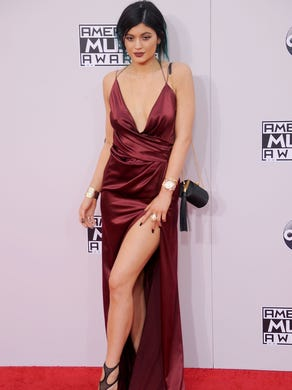 She showed off a lot of leg in a ruby gown with a high slit at the American Music Awards on Nov. 23, 2014, in Los Angeles.