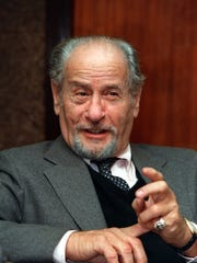 Actor Eli Wallach talks during an interview in New York City on Nov. 1987. (AP Photo/Marty Lederhandler)