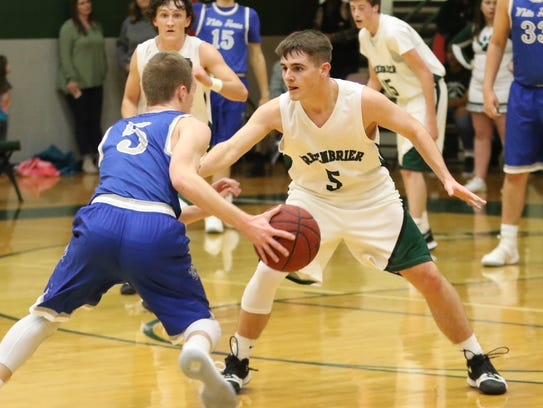 White House's Jared Ward is defended by Greenbrier's
