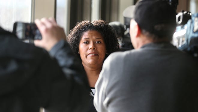 Judge Leticia Astacio is surrounded by media as she leaves City Court after another appearance for allegedly violating her post-conviction conditions. She is scheduled back in court on March 3.