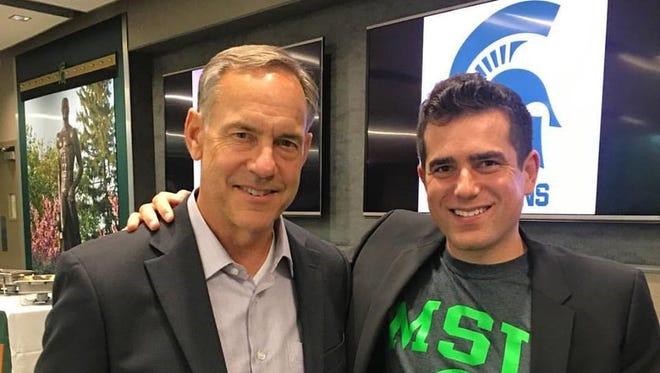 MSU head football coach Mark Dantonio, left, with Mr. Alan's CEO Jacob Bishop.