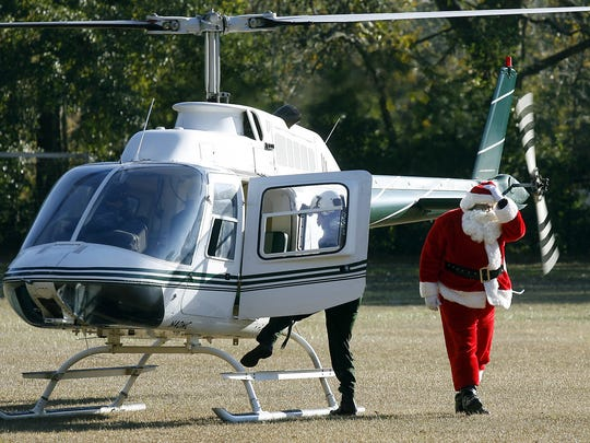 Soul Santa arrives in Frenchtown by helicopter.