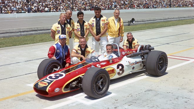 Bob Wilke (lower left), owner of Leader Card Racers, joins his team and driver Bobby Unser for an official photo before the 1968 Indianapolis 500.