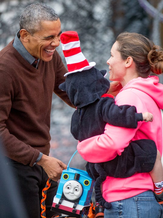 Obama can't handle the cuteness at White House Halloween party