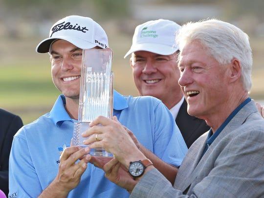 Former President Bill Clinton presents Bill Haas with