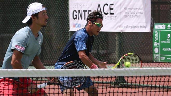 Sho Katayama plays a backhand volley as doubles partner Hiroyasu Ehara looks on against Yuta Shimizu and Kento Takeuchi during a Day 5 match of the 2018 King's Guam Futures at the Hilton tennis courts. Ehara/Katayama won 4-6, 7-5, 10-6.
